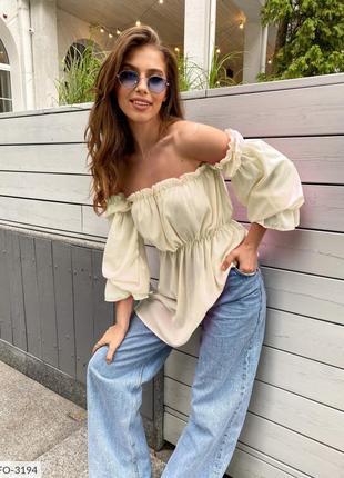 Блуза с открытыми плечами. рукава на резинке.3 фото