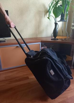 Дорожная сумка - чемодан на колесах