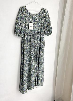 Очень красивое платье в цветочный принт enya, есть тонкий поясок, спинка на пуговках