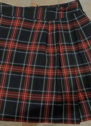 Клетчатая юбка школьницы