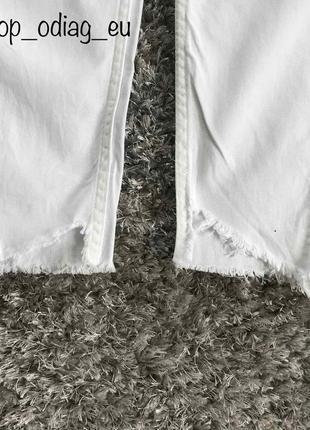 Білі штани джинси