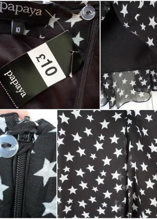 Актуальная черная расклешенная юбка, принт звезды3 фото