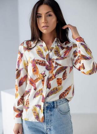 Блуза з принтом пір'я