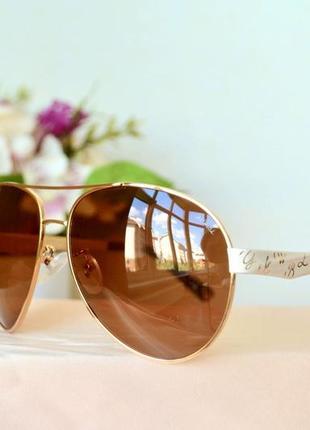 Женские солнцезащитные коричневые очки