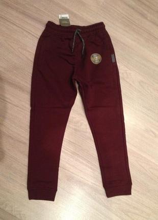 Красивые спортивные штаны next на 7 лет 128см, ягодного цвета