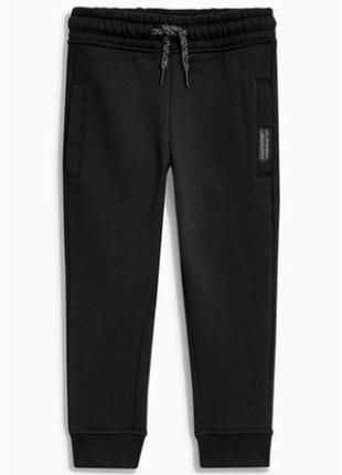 Тепленькие, с начесиком  спортивные штаны next на 9 лет 134см
