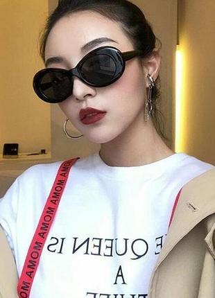Стильні овальні жіночі чорні сонцезахисні окуляри2 фото