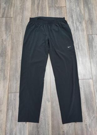Спортивные женские штаны  nike с системой dri-fit running  размер  m