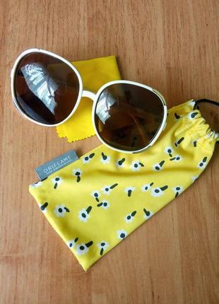 Сонцезахисні окуляри у світлій оправі oriflame 37959 солнцезащитные очки светлые бежевые белые
