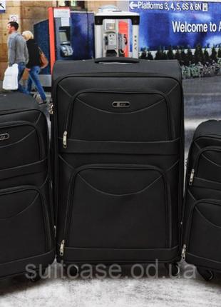 Тканевый дорожный чемодан на 4-х колесх