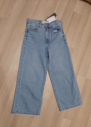 Новые джинсы кюлоты с широкими штанинами укороченные клёш
