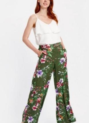 Вискозные широкие брюки в цветочный принт палаццо.