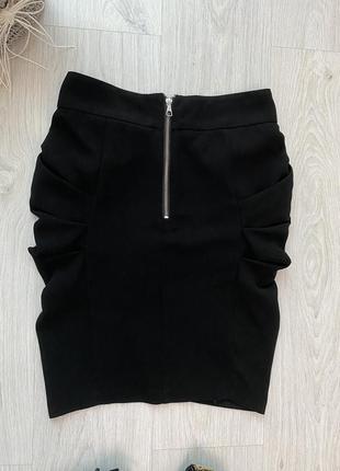 Красивая фирменная чёрная юбка в деловом стиле4 фото