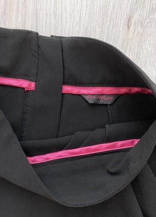 Красивая фирменная чёрная юбка в деловом стиле5 фото