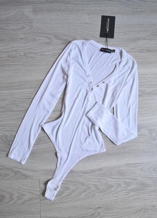 Белый боди с длинным рукавом на кнопках стрингами