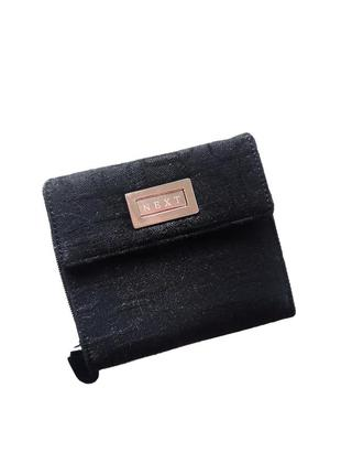Темно чорний ( засвічує камера ) гаманець в ідеальному стані  матеріал  плотна тканина  в ідеальному стані