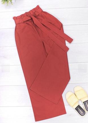 Женские расклешенные брюки с поясом