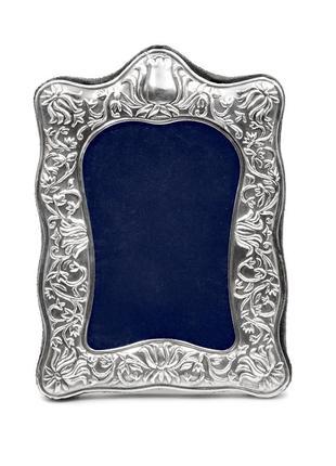 Рамка для фотографий с серебряным окладом.