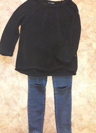 Модный вязаный свитер atmosphere