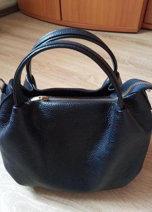 Шкіряна сумочка.