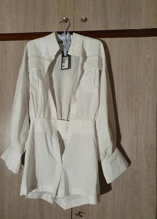 Стильный белоснежный льняной комбинезон с пышными рукавами, білий комбінезон з льону lipinskaya