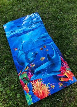 Пляжное полотенца много разных расцветок