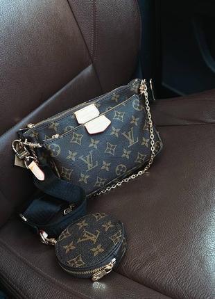 Кожаная коричневая сумочка клатч на цепочке с чёрным ремешком10 фото