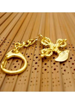 Подвеска-брелок ваджра в золотом цвете символы фэн шуй