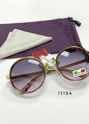 Круглі сонцезахисні окуляри в коричневій оправі к. 11154