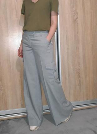 Классические широкие брюки палаццо клеш со стрелками с накладными карманами