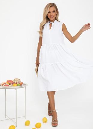 Біле вільне плаття-трапеція без рукавів