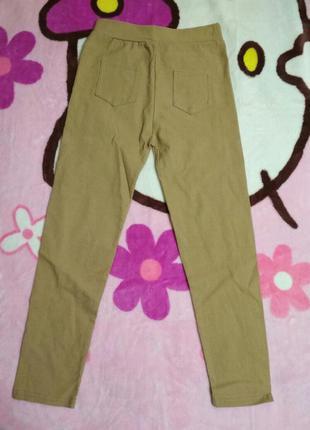 Стрейчивые зауженные штанишки с задними кармашками. возраст 6-7 лет.