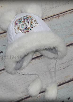 Теплая зимняя шапка ушанка. с помпонами b5e29cde52819