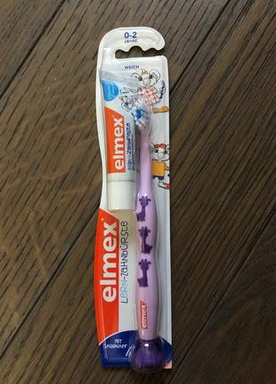 Дитяча зубна щітка elmex learn, м'яка (0-2 років)