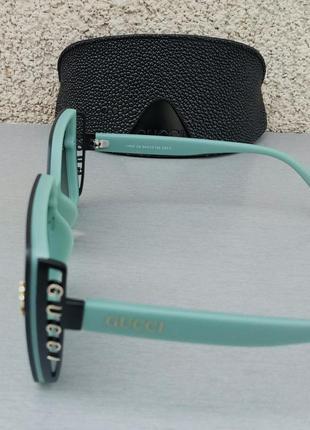 Gucci стильные женские солнцезащитные очки большие линзы чёрный градиент дужки бирюзовые4 фото