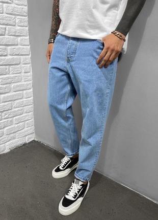 Топові мом джинси в світлому кольорі