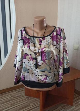 Яркая свободная блуза