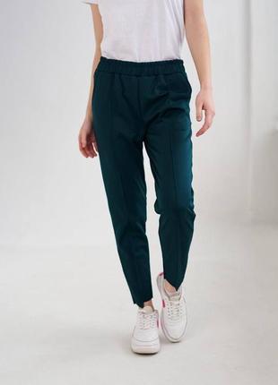 Темно - зеленые трикотажные женские штаны, разные цвета