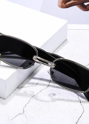 Очки солнцезащитные с кольцом черный в серебре