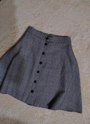 Короткая юбка в клетку на высокой посадке