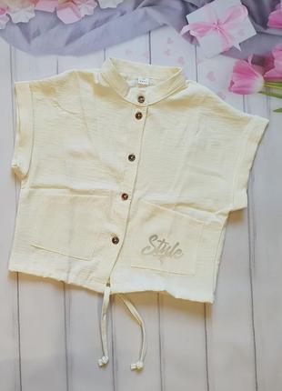 Стильная рубашка-топ украшена светоотражающей термо наклейкой