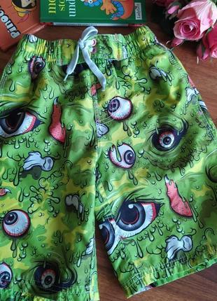Классные пляжные шорты для парнишки urban на 7-8 лет.