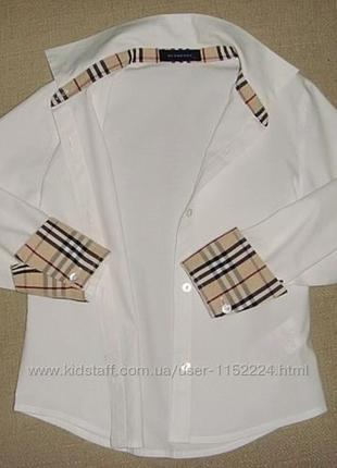 Женская рубашка с вышитым логотипом