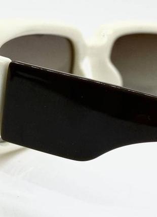 Женские солнцезащитные очки с поляризованными линзами  в пластиковой оправе прямоугольники бежевые2 фото