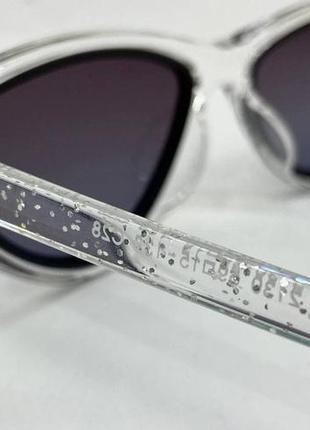 Женские солнцезащитные очки треугольники в прозрачной оправе с поляризованными линзами4 фото
