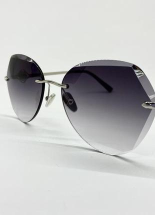 Женские солнцезащитные очки безоправные льдинки серые линзы с градиентом серебристая фурнитура
