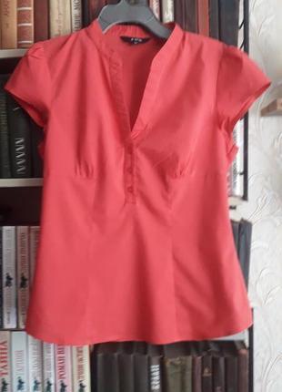 Приталенная блуза розового цвета