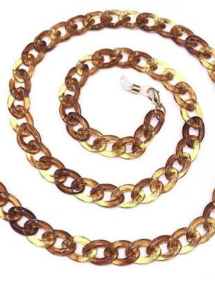 Цепочка акриловая для очков янтарного цвета с золотистой фурнитурой