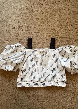 Стильная блуза с рукавами пуфами