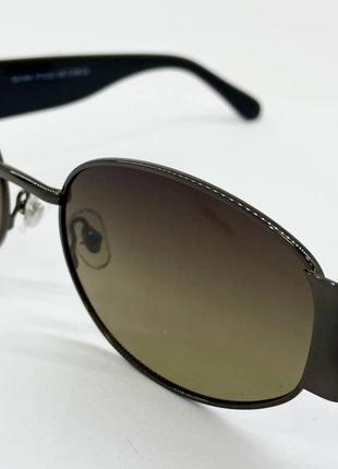 Солнцезащитные очки овальные серо-зеленые линзы с поляризацией с пластиковыми широкими дужками1 фото